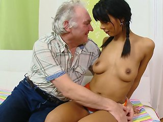 FLASH !!! Kim has been fucked hard in the pussy and ass and wants his older cum all over her. She kneels before him and takes his cum over her young petite tits and loves it.